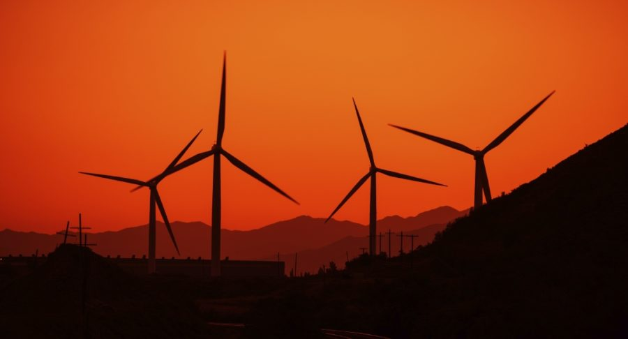 Wind Energy Concept. Wind Turbines and the Sunset.